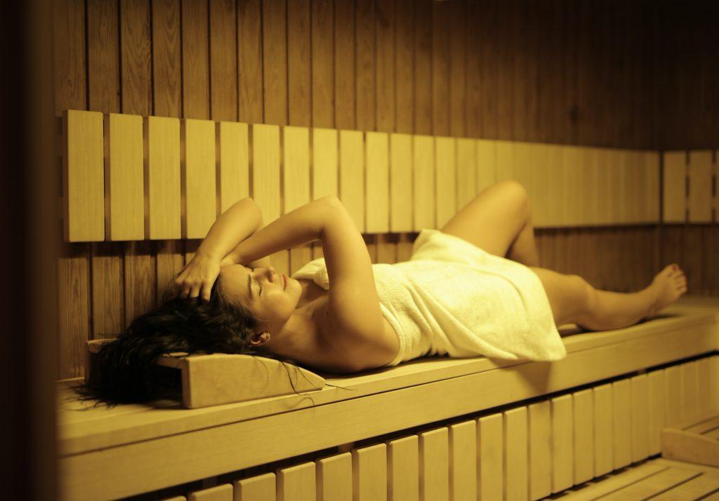 wearing a towel in sauna room